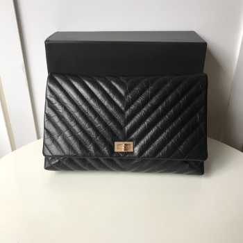 Chanel Palm print calfskin clutch